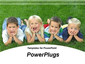 PowerPoint template displaying four small children lying on grassy field making funny faces