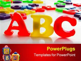 PowerPoint template displaying children's colorful plastic letters spelling out ABC in the background.