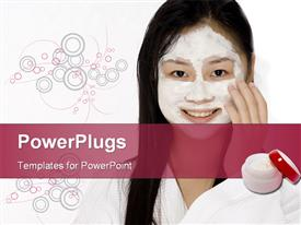 PowerPoint template displaying young Asian woman in a bath robe with a face pack on