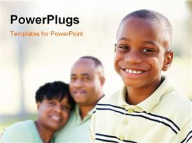 PowerPoint template displaying handsome African American Boy with Proud Parents Standing By in the Park