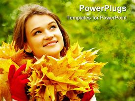 PowerPoint template displaying charming woman in autumnal environment looking upwards in the background.