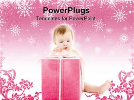 PowerPoint template displaying depiction of baby boy with big gift box in the background.