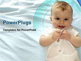 PowerPoint template displaying baby laughing on the bed looking innocent