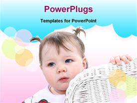 PowerPoint template displaying baby peeking around edge of wicker chair