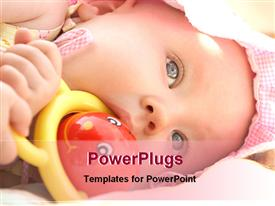 PowerPoint template displaying baby playing with toy