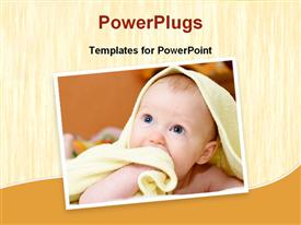 PowerPoint template displaying cute baby wrapped in a towel looking up