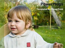 PowerPoint template displaying young baby smiling with a wide gren field behind her