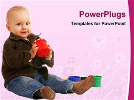 PowerPoint template displaying cute little boy playing with set of toy on floral background