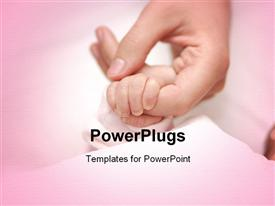 PowerPoint template displaying newborn hold mothers finger in fist