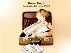 PowerPoint template displaying baby reading newspaper inside of suitcase