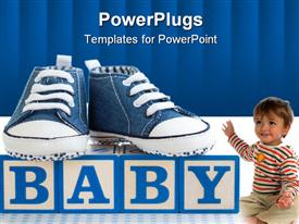 Baby blocks with blue denim baby shoes powerpoint theme