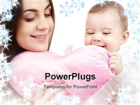 PowerPoint template displaying happy baby and mama with heart-shaped pillow and snowflakes in the background.