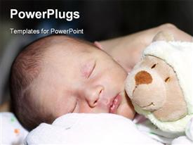 PowerPoint template displaying cute little baby sleeping beside teddy bear
