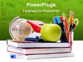 Assorted school aids and green apple shot powerpoint template