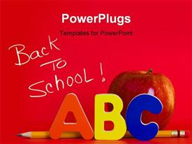 PowerPoint template displaying red apple with ABC letters and a pencil on red background