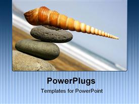 PowerPoint template displaying spiral shell on stone stack by the beach in the background.
