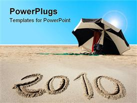 PowerPoint template displaying new year 2010 written on beach sand
