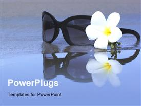 PowerPoint template displaying reflection of Sunglasses and plumeria flower on the beach in the background.