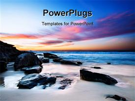 PowerPoint template displaying beautiful field with black rocks in beach sand and colored sky