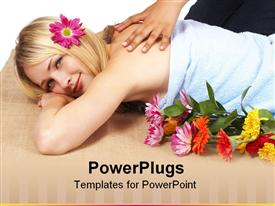 PowerPoint template displaying smiling blond woman with flower in head enjoying massage at spa with colorful flowers on bed