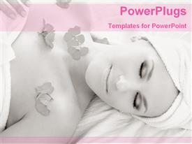 PowerPoint template displaying a lady lying for spa with flowers on her chest