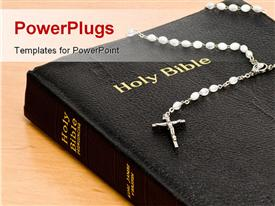 PowerPoint template displaying rosary on Holy Bible sitting on wooden table