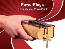 Man's hand holds the old bible with a cross on a chain powerpoint design layout
