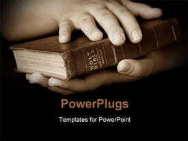 PowerPoint template displaying pair hands holding well read Holy Bible