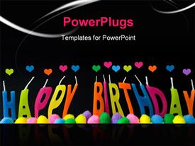 Birthday greeting in multi colored wax candles on blackhearts template for powerpoint