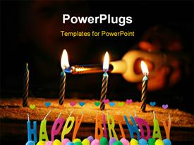 PowerPoint template displaying a close up view of a cake with candles and lights