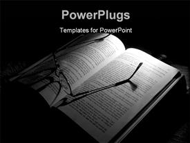 PowerPoint template displaying a light shinning on an open book with a pair of glasses