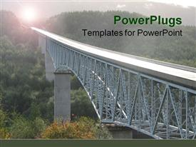 PowerPoint template displaying long steel structured bridge on a natural green landscape