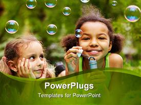 PowerPoint template displaying two female kids blowing bubbles on a green background