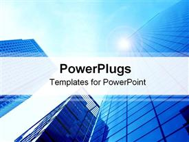 PowerPoint template displaying 3 blue skyscraper buildings viewed from below with blue sky and sunburst