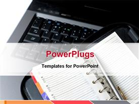PowerPoint template displaying an open note book on a black open laptop