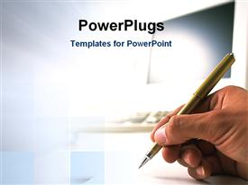 PowerPoint template displaying human hand holding ball point pen writes with blurred computer monitor behind