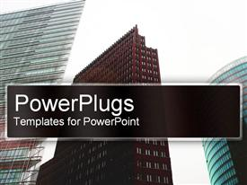 PowerPoint template displaying head up shot of three tall brown and silver sky scrappers