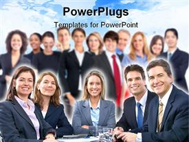 PowerPoint template displaying large team of business people smiling to the camera with five people sitting at the table and a team standing in the background