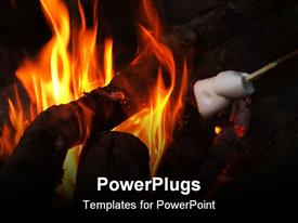 PowerPoint template displaying a close up view of a camp fire with flames and wood