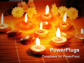 PowerPoint template displaying flowers, pebbles, and burning tea light candles arranged on bamboo mat