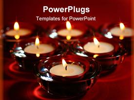 PowerPoint template displaying group of burning tea light candles and red holders arranged in triangle