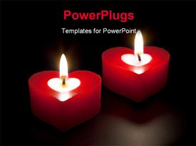 PowerPoint template displaying two lit red colored heat shaped candles in the dark