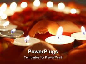 PowerPoint template displaying a number of burning candles with blurred background