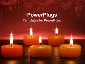 PowerPoint template displaying orange Christmas candles on red background close up in the background.