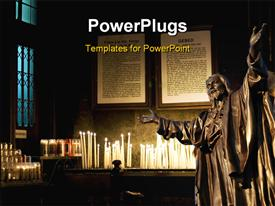 PowerPoint template displaying religious sculpture in building with several lighted candles and prayer book