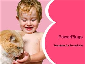 PowerPoint template displaying a cute young clothes baby playing with a cat