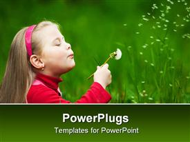 Little blond girl puffing a dandelion with flying seeds powerpoint theme