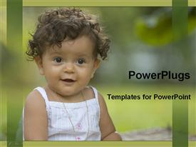 PowerPoint template displaying a small baby girl wearing a white dress and smiling