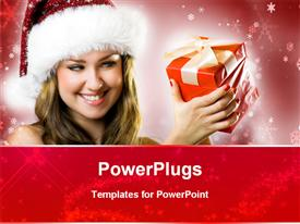 PowerPoint template displaying pretty female wearing a christmas cap and smiling with a gift