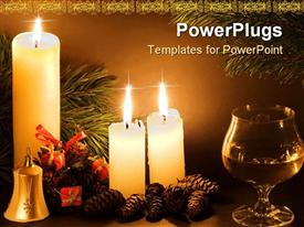 PowerPoint template displaying christmas scene with white candles cones bell and glass of wine in low light in the background.